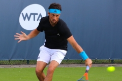 Andrea Arnaboldi slicing a backhand