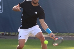 Andrea Arnaboldi hits a low forehand