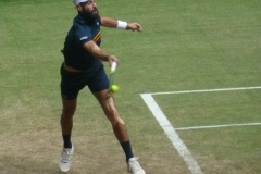 Benoit Paire hits a forehand return