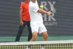 Bernard Tomic hits a backhand