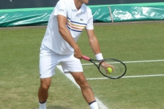 Bernard Tomic serving