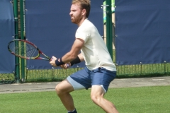 Bjorn Fratangelo ready to return a forehand