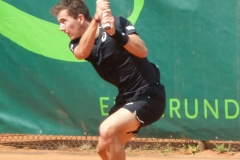 Corentin Denolly hits a tough backhand