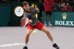 Dominic Thiem plays a defensive forehand