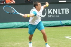 Evgeny Donskoy reaches to return a serve