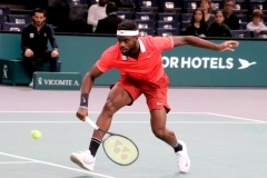 Frances Tiafoe hits a volley