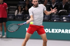 Gilles Simon hammers a forehand