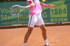 Henri Squire hits a high forehand