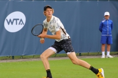 Jannik Sinner sprints to reach a deep forehand shot