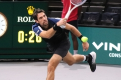 Jeremy Chardy stretching to make a return