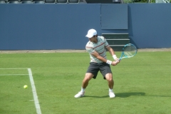 Jordan Thompson warming up the backhand