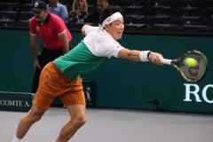 Kei Nishikori stretching to save a point