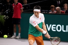 Kei Nishikori prepares to hit a backhand