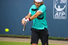 Lukas Lacko hits a backhand