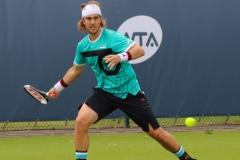 Lukas Lacko ready to hit a forehand