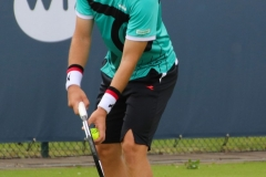Lukas Lacko prepares to serve to Jannik Sinner
