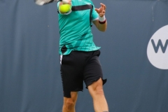 Lukas Lacko whacks a topspin forehand