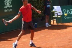 Lukas Rosol preparing to hammer a forehand