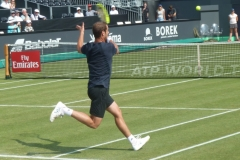 Richard Gasquet hits a wide forehand return