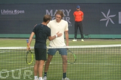 Richard Gasquet greets Stefanos Tsitsipas at the net after victory