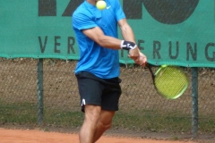 Ronald Slobodchikov lining up a topspin backhand