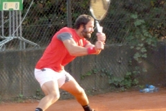 Teymuraz Gabashvili slides after a backhand shot