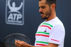 Thomas Fabbiano checking racquet strings