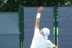 Tim Smyczek serving