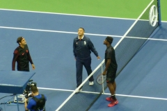 Roger Federer and Frances Tiafoe witness the toss by Mohamed Lahyani
