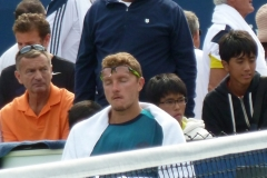Denis Istomin looks exhausted in the fifth set