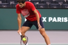 Pierre-Hugues Herbert hits a low volley