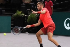 Borna Coric picks up a ball from the baseline
